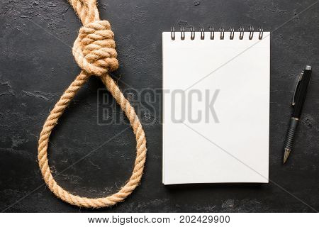 Suicide Rope Loop And A Note On A Black Background