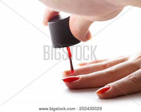 hand care nail painting with red lacquer