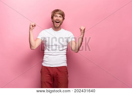 Portrait of young man with happy facial expression at studio