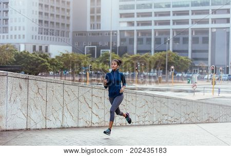 Woman Running On Street In The Morning