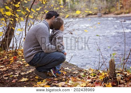 Exploring the nature with dad in forest autumn