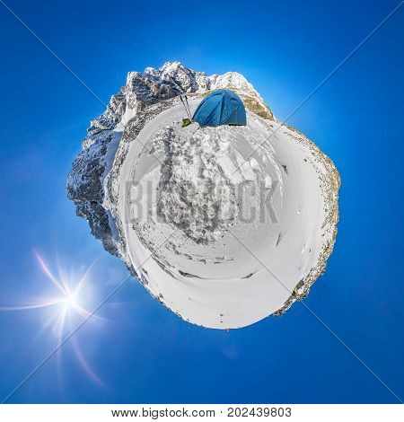 Blue Tent In The Snowy Peaks Of The Mountains. A Spherical 360 180 Panorama Of A Little Planet