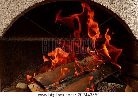 A nice fire in a fire place. prepare for grill time