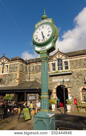 Betws y Coed Wales UK - August 15 2017: The village clock outside Betws-y-Coed railway station built in 1868 the station buildings now house various shops and cafes