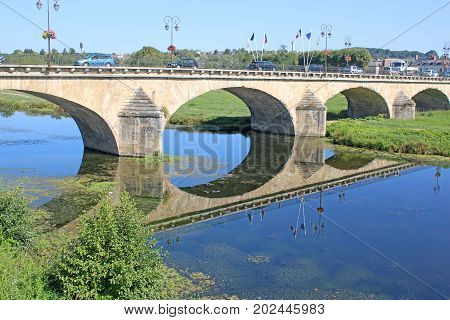 Bridge reflected in the river at Selles sur cher, France