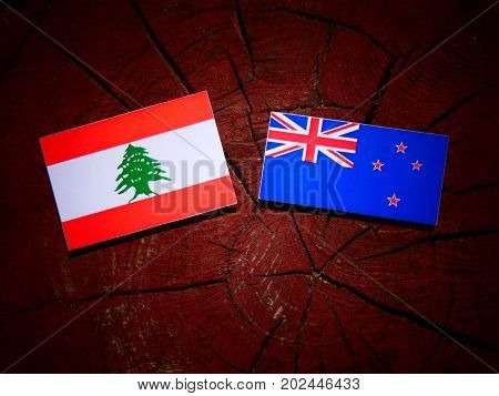 Lebanese Flag With New Zealand Flag On A Tree Stump Isolated