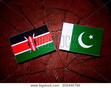 Kenyan Flag With Pakistan Flag On A Tree Stump Isolated