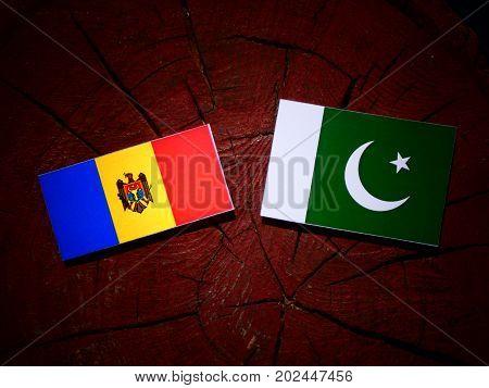 Moldovan Flag With Pakistan Flag On A Tree Stump Isolated