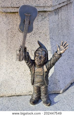 WROCLAW POLAND - JUNE 2017: Wroclaw a miniature statue of a gnome on the main square of the city. A dwarf with a guitar. The concept of music.