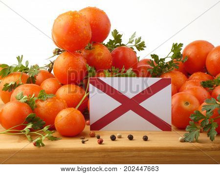 Alabama Flag On A Wooden Panel With Tomatoes Isolated On A White Background