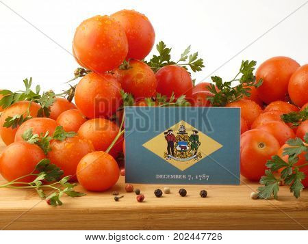 Delaware Flag On A Wooden Panel With Tomatoes Isolated On A White Background