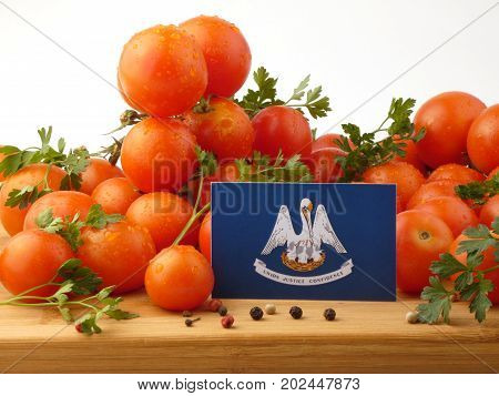 Louisiana Flag On A Wooden Panel With Tomatoes Isolated On A White Background