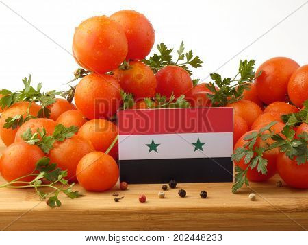 Syria Flag On A Wooden Panel With Tomatoes Isolated On A White Background