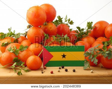 Sao Tome And Principe Flag On A Wooden Panel With Tomatoes Isolated On A White Background