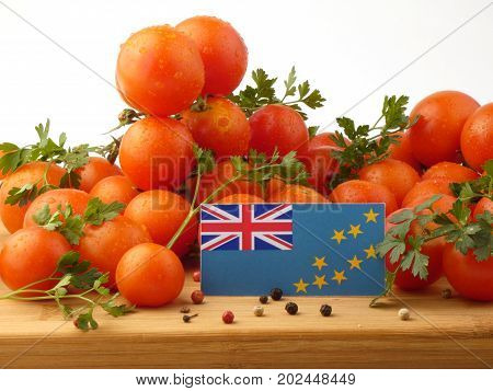 Tuvalu Flag On A Wooden Panel With Tomatoes Isolated On A White Background