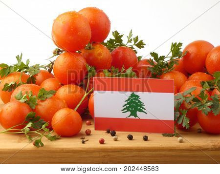 Lebanese Flag On A Wooden Panel With Tomatoes Isolated On A White Background