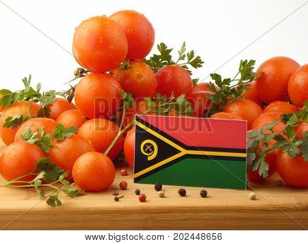 Vanuatu Flag On A Wooden Panel With Tomatoes Isolated On A White Background