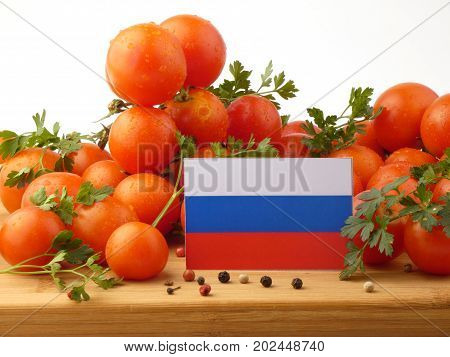 Russia Flag On A Wooden Panel With Tomatoes Isolated On A White Background