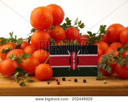 Kenyan Flag On A Wooden Panel With Tomatoes Isolated On A White Background