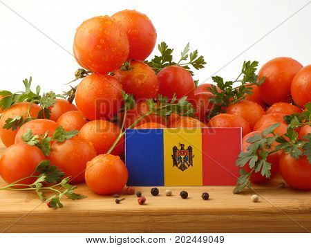 Moldovan Flag On A Wooden Panel With Tomatoes Isolated On A White Background