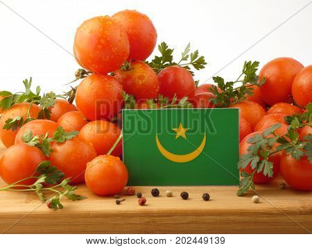 Mauritania Flag On A Wooden Panel With Tomatoes Isolated On A White Background