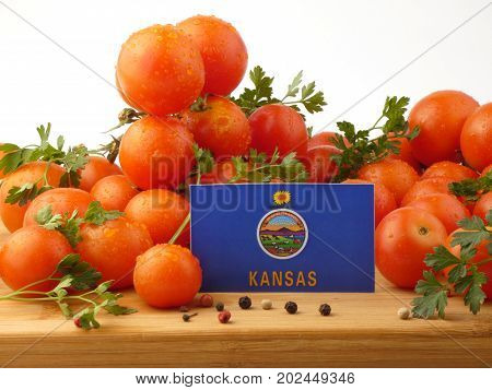 Kansas Flag On A Wooden Panel With Tomatoes Isolated On A White Background