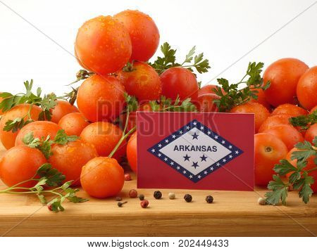 Arkansas Flag On A Wooden Panel With Tomatoes Isolated On A White Background