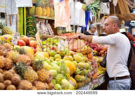 JERUSALEM ISRAEL - APRIL 2017: Market sketch Israeli trade seller in Israely Market Mahane Yehuda Jerusalem