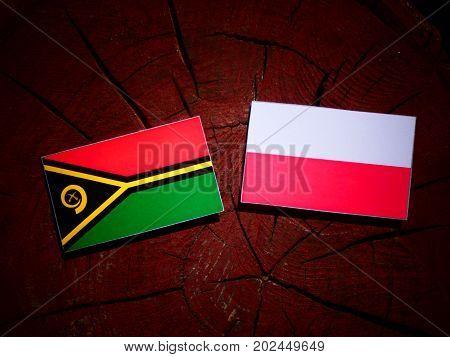 Vanuatu Flag With Polish Flag On A Tree Stump Isolated