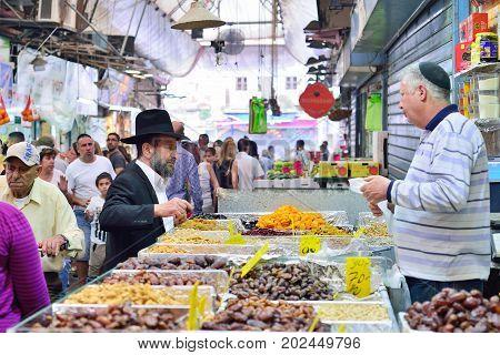 JERUSALEM ISRAEL - APRIL 2017: Market sketch Israeli trade seller and buyer in Israely Market Mahane Yehuda Jerusalem
