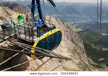 Ramsau Am Dachstein, Austria - August 17: Gondola With Tourists In The Upper Station Of The Dachstei