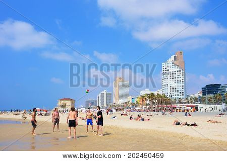 TEL AVIV ISRAEL - APRIL 2017: Tel Aviv beach with some of its famous hotels Mediterranean sea.
