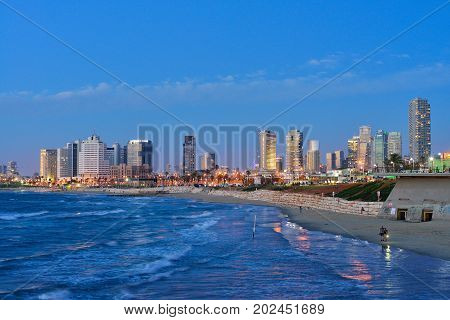 TEL AVIV ISRAEL- APRIL 2017: Evening view of the skyscrapers of Tel Aviv from the Mediterranean Sea.