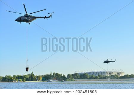 ROSTOV-ON-DON RUSSIA - AUGUST 21 2017: military helicopters collect water from the don river to extinguish a fire Rostov-on-don Russia.