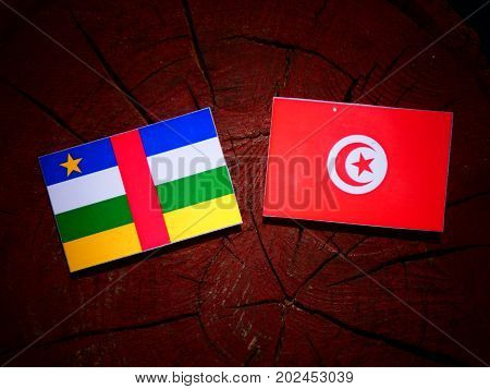 Central African Republic Flag With Tunisian Flag On A Tree Stump Isolated
