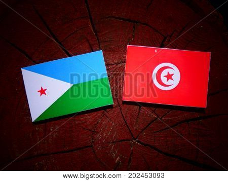 Djibouti Flag With Tunisian Flag On A Tree Stump Isolated