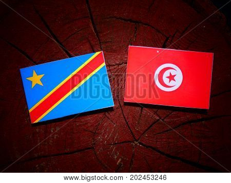 Democratic Republic Of The Congo Flag With Tunisian Flag On A Tree Stump Isolated