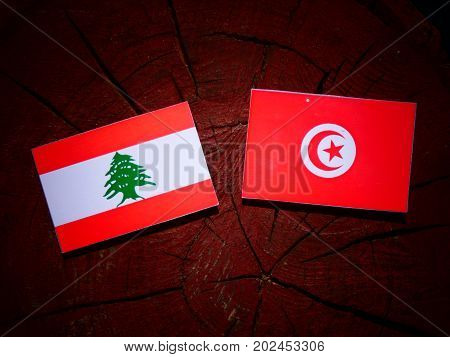 Lebanese Flag With Tunisian Flag On A Tree Stump Isolated
