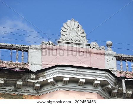 Architectural decor. Architecture.  Fragment of an old building with decor. Architectural background. Pink house. Ust-Kamenogorsk.