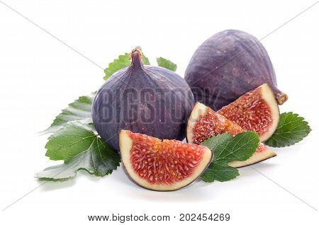 Fruits Of Fig Tree ( Whole And Part) With Leaves Isolated On White