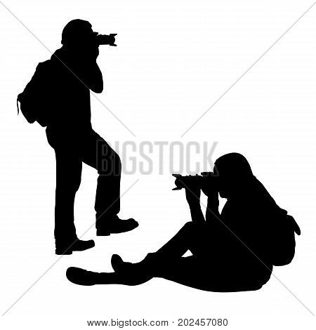 set of vector silhouettes of sitting and standing photographer with telephoto isolated on white background