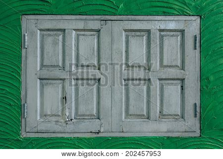 vintage windows on the green wall background concept