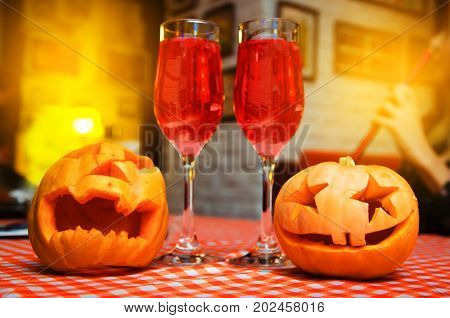 Halloween. Two Pumpkin Heads On The Background Of A Table And Two Glasses. The Feast Of The Dead. Pu