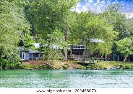Old Bungalows on Green River Bank in Summer