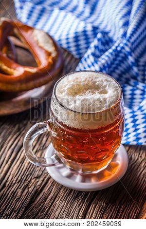 Beer And Oktoberfest. Draft Beer Pretzel And Blue Checkered Tablecloth As Traditional Products For B