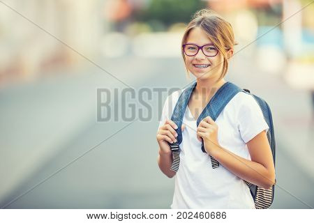 Schoolgirl With Bag, Backpack. Portrait Of Modern Happy Teen School Girl With Bag Backpack. Girl Wit