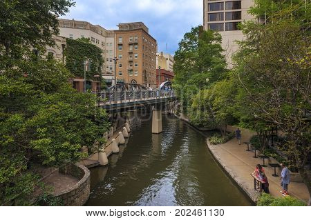 San Antonio Texas - June 5 2014: People walking by the Riverwalk in the city of San Antonio in Texas USA