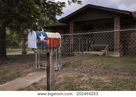 Mailbox painted with the Texas Flag in fron of a house in Texas USA; Concept for travel in Texas