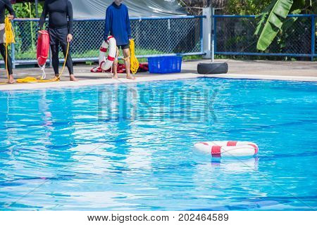 lifebuoy or ringbuoy in the pool water equipment for save life in water