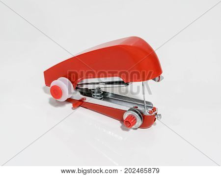 Red Handheld Sewing Machine Isolated On White
